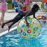 Child with ball at Rutherford Pool in Ypsilanti